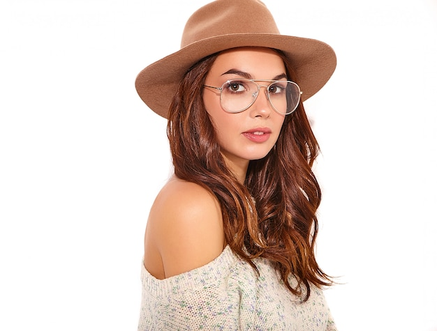 Portrait of young stylish girl model in casual summer clothes in brown hat with natural makeup in glasses isolated.