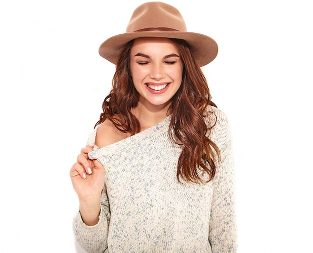 Portrait of young stylish girl model in casual summer clothes in brown hat with natural makeup isolated.