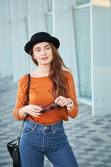 Portrait of young stylish girl