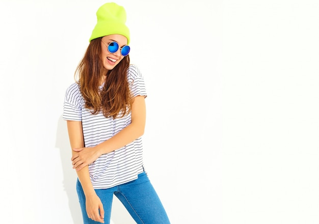 Portrait of young stylish woman model in casual summer clothes in yellow beanie hat. isolated on white