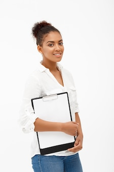 Portrait of young successful african business lady over white wall
