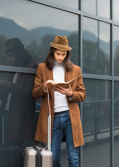 Portrait of young traveler reading