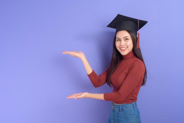 Portrait of young university student woman with graduation cap