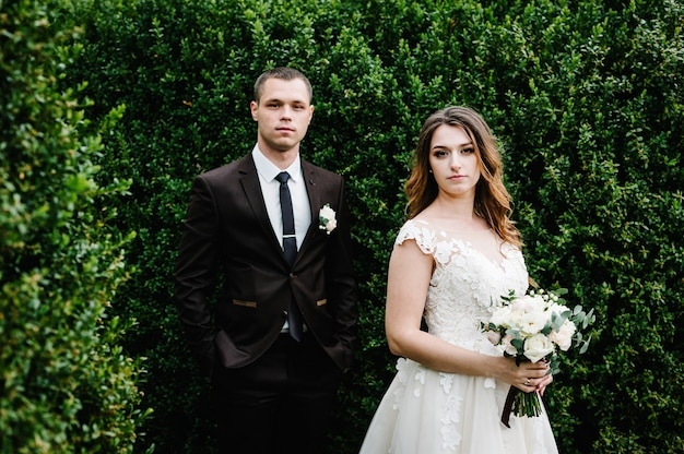 Portrait of young wedding couple at nature.