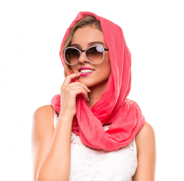 Portrait of a young woman in bright crimson headscarf.