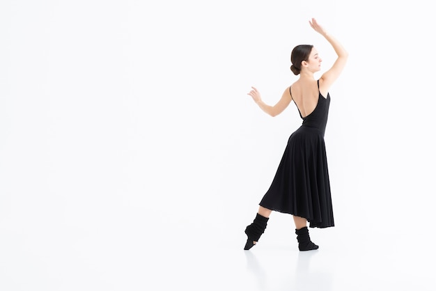 Portrait of young woman dancing with elegance