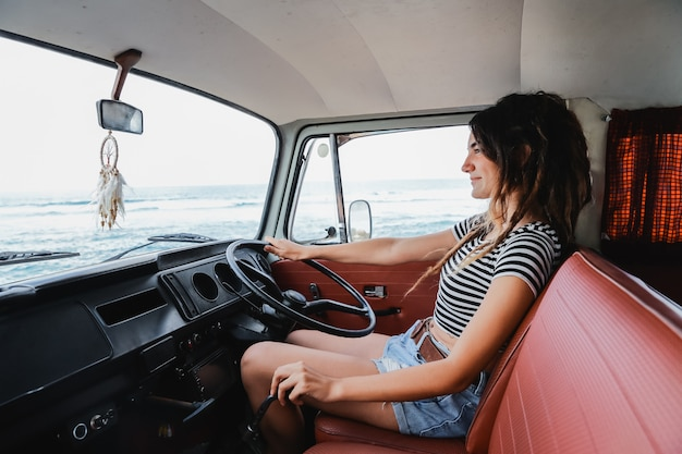 Portrait young woman driver relaxing enjoy the trip