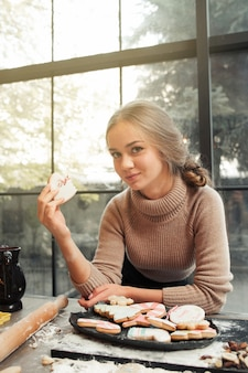 Portrait of young woman eating cookie heart