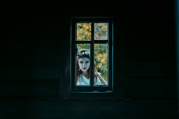 Portrait of a young woman from nightmares , halloween concept.