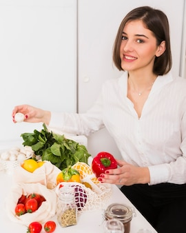 Portrait of young woman happy with groceries
