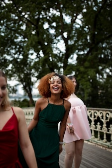 Portrait of young woman next to her friends at prom