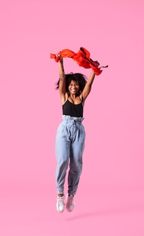 Portrait young woman jumping