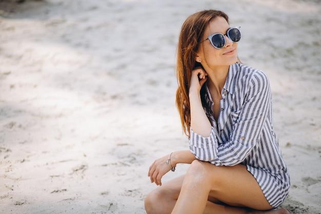 Portrait of a young woman n shirt at the beach