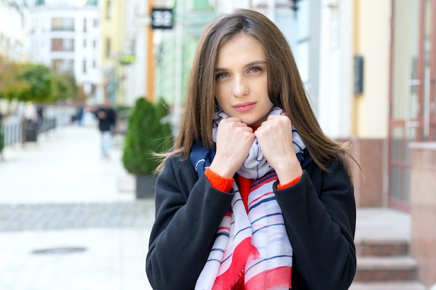 Portrait of a young woman on an old european city