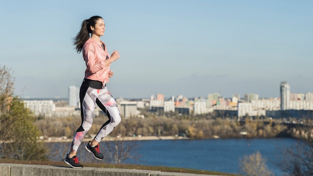 Portrait of young woman running outdoor