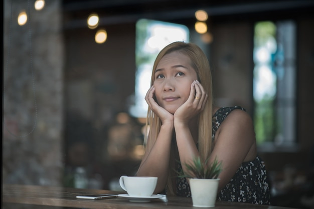 Portrait of young woman smiling in coffee shop cafe