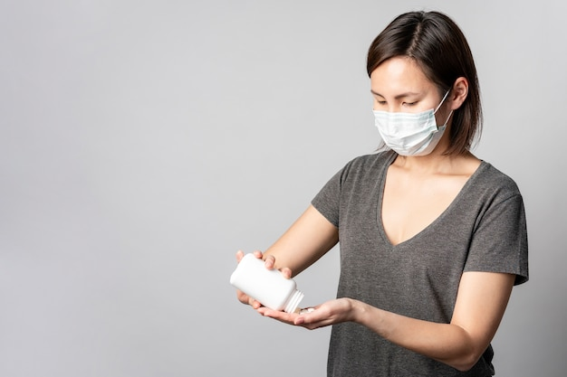 Portrait of young woman taking medical treatment