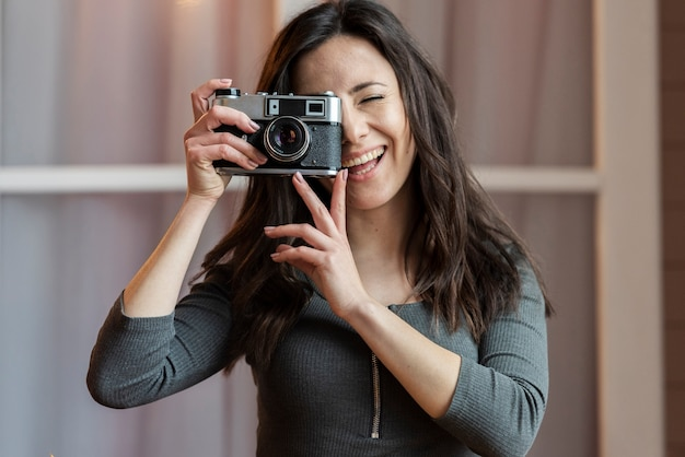 Portrait of young woman taking a picture