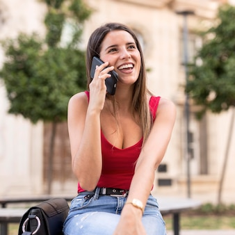 Portrait of young woman talking on the phone