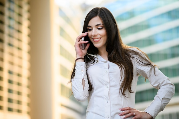 Portrait of a young woman talking on the phone