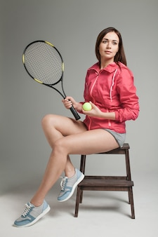 Portrait of young woman tennis player