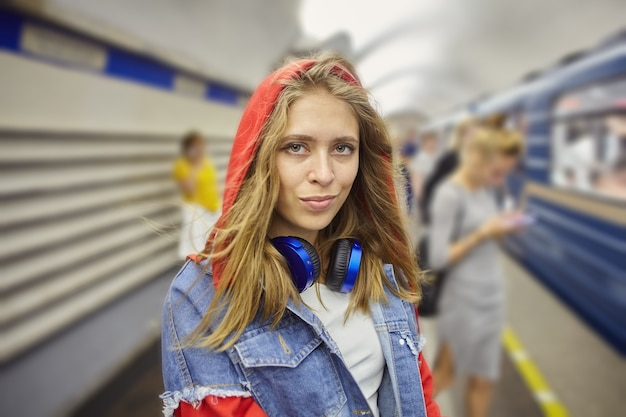 Portrait of young woman on underground station.