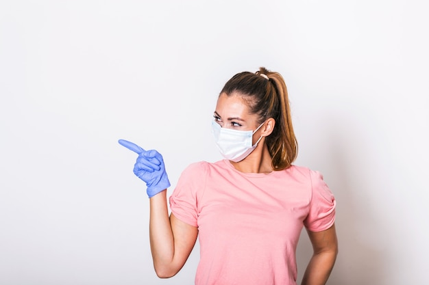 Portrait of young woman wearing face protective mask to prevent coronavirus and anti-smog.