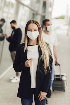 Portrait of a young woman wearing a protective face mask