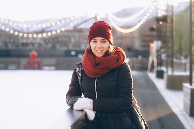 Portrait of a young woman in winter at the ice rink