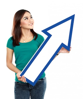 Portrait of young woman with arrow sign
