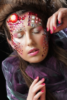 Portrait of young woman with creative visage, halloween picture.
