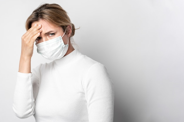 Portrait of young woman with fever symptom