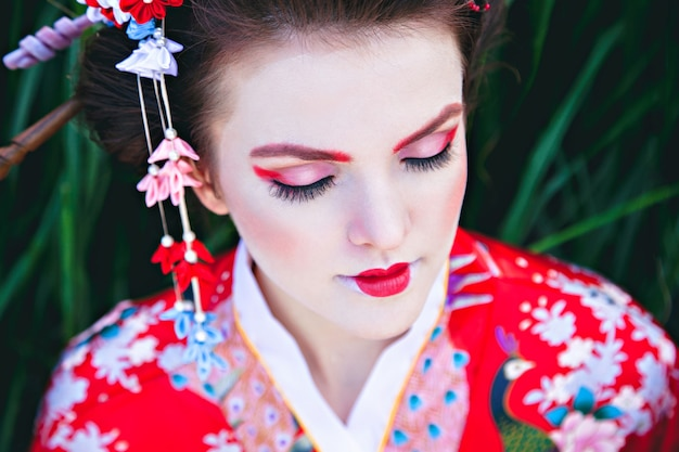 Portrait of young woman with geisha fancy makeup