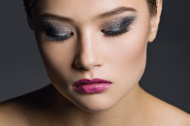 Portrait of young woman with glamorous make-up