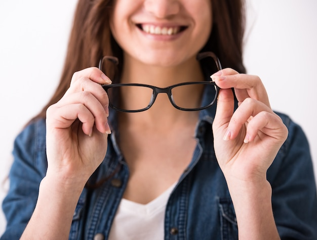Portrait of a young woman with glasses