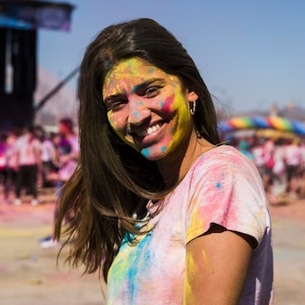Portrait of a young woman with holi powder