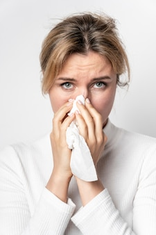 Portrait of young woman with illness symptom