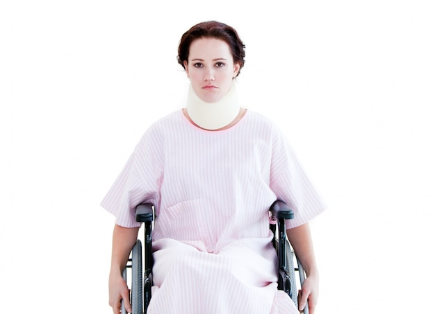 Portrait of a young woman with a neck brace sitting on a wheelch