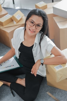 Portrait young woman with online business working at home