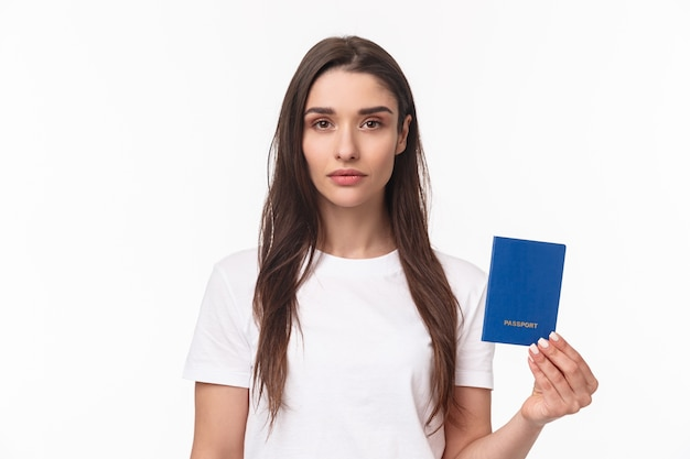 Portrait young woman with passport