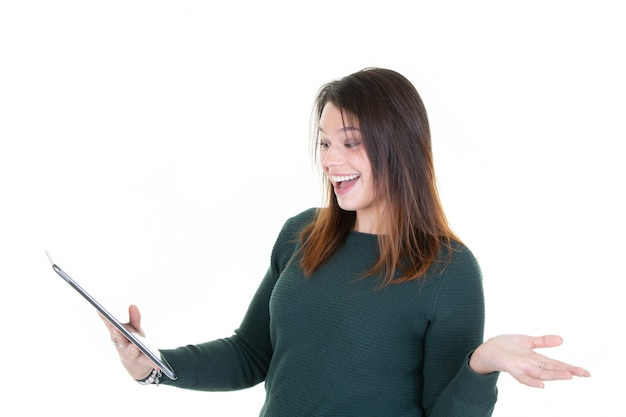 Portrait of young woman with phone surprised looks smartphone