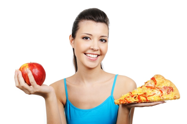 Portrait of young woman with pizza and red apple