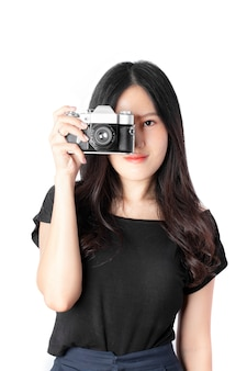 Portrait of young woman with retro film camera isolated