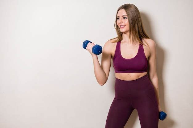 Portrait of young woman working out