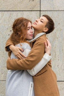 Portrait of young women hugging each other