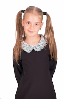 Portrait of the youngest schoolgirlisolated on white background.