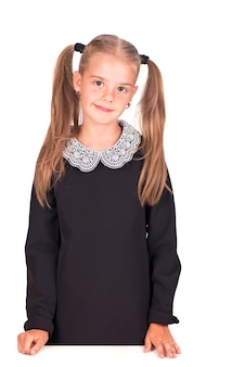 Portrait of the youngest schoolgirlisolated on white surface
