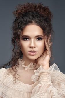 Portraite of curly beauty brunette.