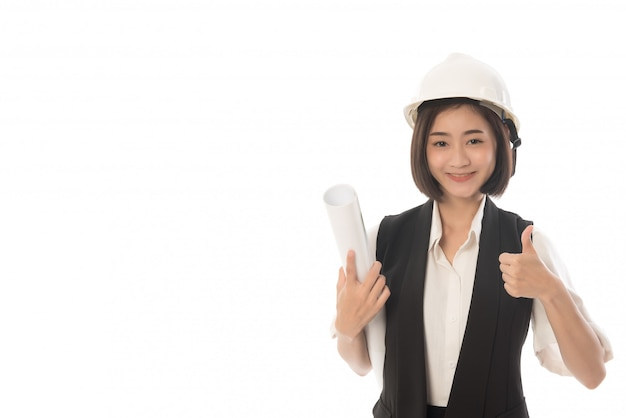 Portraitf of woman engineer with a blueprint in hand and showing thumbs up isolated on white
