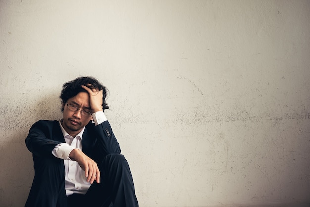 Portraits of asian businessman stressed from work